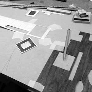 Detailed wood inlay is measured and cut